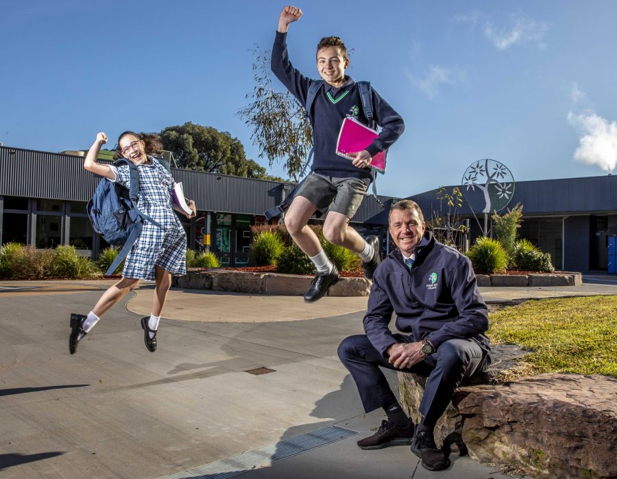 Year 7s at Forest Hill College celebrating heading back to school on Tues. Felix Rodrigues, 13, and Jennifer Schutz, 13. Principal David Rogers.  Picture: Tim Carrafa